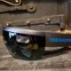 Augmented Reality Device Microsoft Hololens closeup branded with OneDeadPixel logo and text in blue